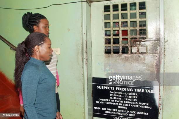 Zambian Newspaper 'The Post' managing editor Joan ChirwaNgoma and reporter Mukosha Funga are led to detention at Lusaka Central Police on April 12...