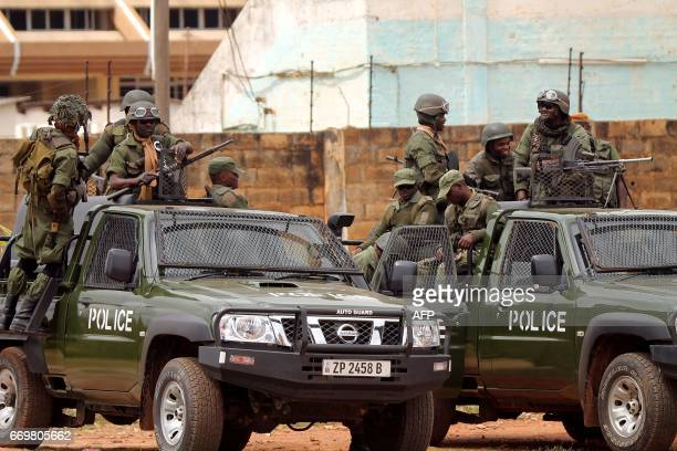 Zambian police officers patrol outside a courtroom during the hearing of the leader of the opposition United Party for National Development in Lusaka...