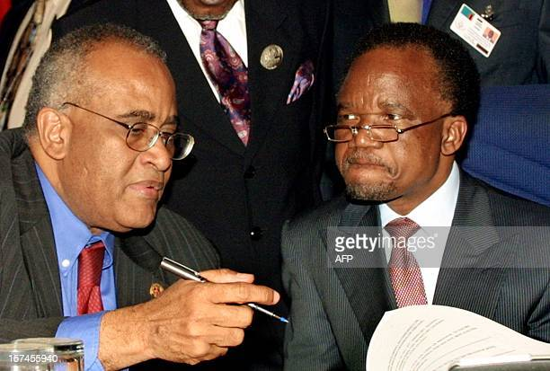 Zambian President Frederick Chiluba speaks with the outgoing secretary general of Organisation of African Unity Salim Ahmed Salim 11 July 2001 during...