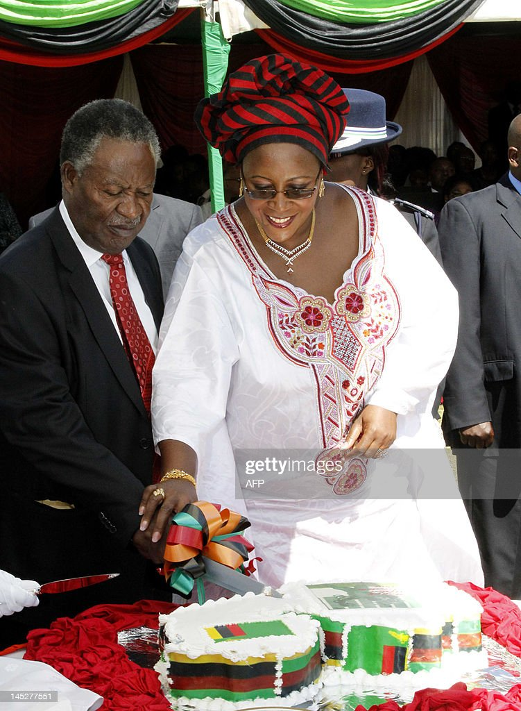 Zambian President <a gi-track='captionPersonalityLinkClicked' href=/galleries/search?phrase=Michael+Sata&family=editorial&specificpeople=1944545 ng-click='$event.stopPropagation()'>Michael Sata</a> and First Lady Dr Christine Kaseba cut the National Cake on Friday's Africa Freedom Day after the Head of State announced the pardon of 2, 318 prisoners, the largest number of released inmates at once in the history of the country, on May 25, 2012 in Lusaka. AFP PHOTO / Joseph Mwenda