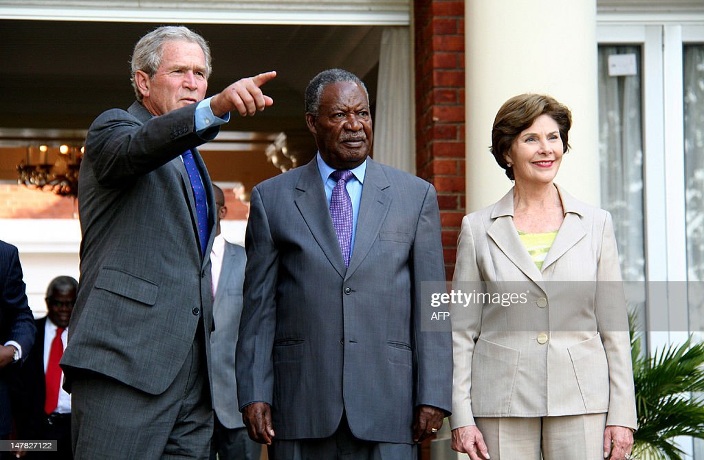 Zambian President <a gi-track='captionPersonalityLinkClicked' href=/galleries/search?phrase=Michael+Sata&family=editorial&specificpeople=1944545 ng-click='$event.stopPropagation()'>Michael Sata</a> (C) flanked by former US President George W. Bush and his wife Laura, pose on July 4, 2012 at the State house in Lusaka. Bush is in Zambia as part of a cervical and breast cancer awareness campaign. AFP PHOTO / JOSEPH MWENDA