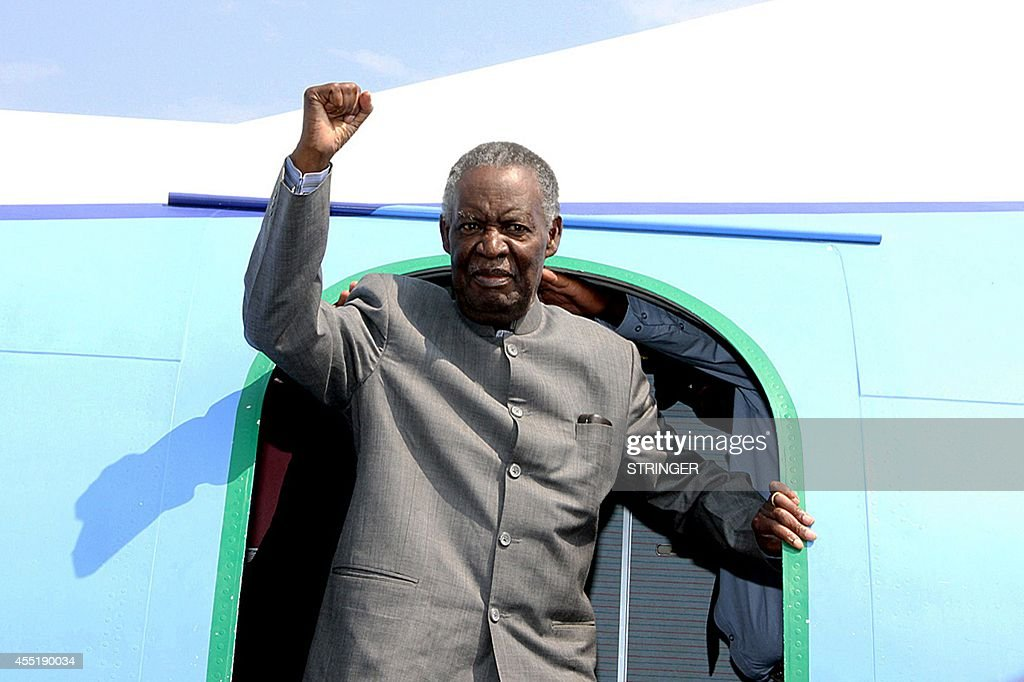 Zambian President <a gi-track='captionPersonalityLinkClicked' href=/galleries/search?phrase=Michael+Sata&family=editorial&specificpeople=1944545 ng-click='$event.stopPropagation()'>Michael Sata</a> gestures upon arrival at Solwezi airport before addressing supporters at an election campaign meeting on September 10, 2014. The next national election in Zambia is not due until 2016, but in the event of ailing 77-year-old Sata's death a presidential vote would have to be held within 90 days. AFP PHOTO / STRINGER