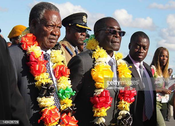 Zambian President Michael Sata is welcomed by Zimbabwean President Robert Mugabe at the Harare International Airport on April 25 2012 in Harare...