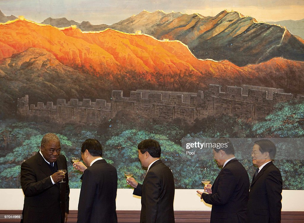 Zambian President Rupiah Bwezani Banda toasts with Chinese ministers after a signing ceremony in the Great Hall of the People in Beijing China on...