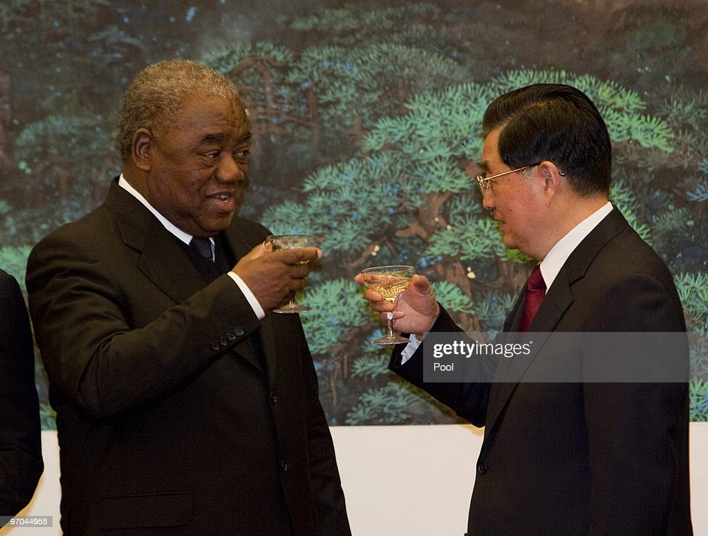 Zambian President Rupiah Bwezani Banda toasts with Chinese President <a gi-track='captionPersonalityLinkClicked' href=/galleries/search?phrase=Hu+Jintao&family=editorial&specificpeople=203109 ng-click='$event.stopPropagation()'>Hu Jintao</a> after a signing ceremony in the Great Hall of the People in Beijing, China on February 25, 2010. Zambian and Chinese ministers signed a range of mining, trade and cultural agreements.