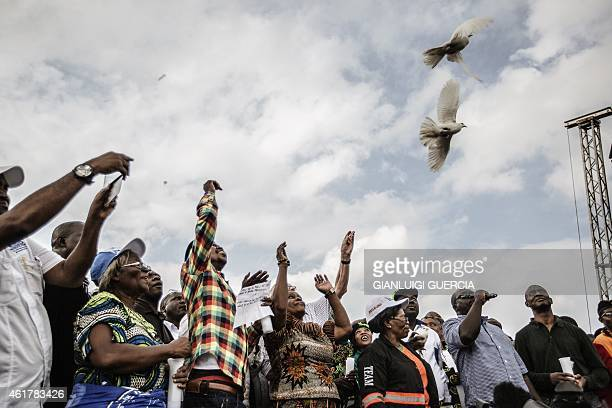 Zambian ruling party Patriotic Front presidential candidate Edgar Lungu and National leadership release white doves during the last presidential...