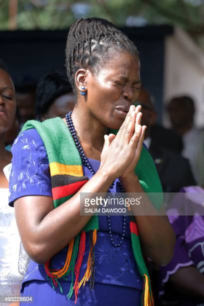 A Zambian woman prays as thousands of Zambians rally to pray against the depreciation of the countrys currency and economic crisis at the Lusaka Show...