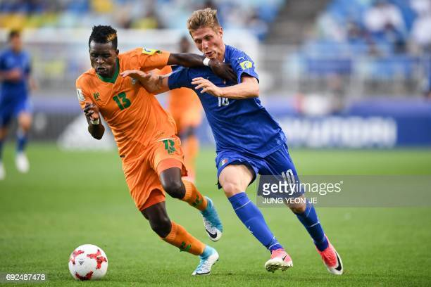 Zambia's defender Shemmy Mayembe and Italy's forward Luca Vido compete for the ball during the U20 World Cup quarterfinal football match between...