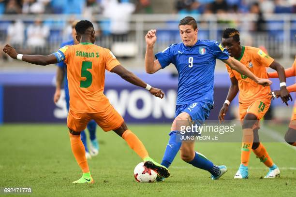 Zambia's defender Solomon Sakala and Italy's forward Andrea Favilli compete for the ball during the U20 World Cup quarterfinal football match between...