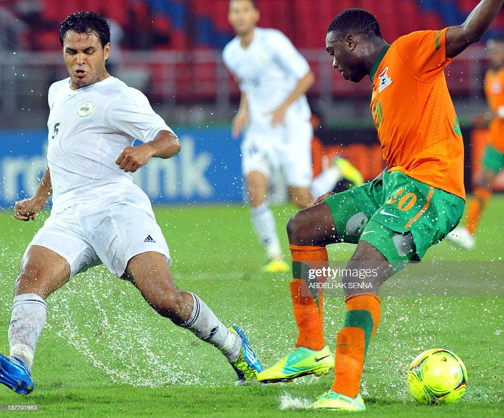 Zambia s Emmanuel Mayuka R vies with L