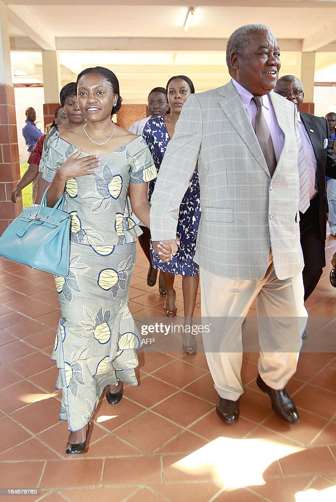 Zambia's ex-president Rupiah Banda (R) and his wife Thandiwe arrive at the Lusaka court, on March 26, 2013. Banda pleaded not guilty to a charge of abuse of power linked to an oil contract signed while he was in office. He was arrested on March 25, 2013 after being questioned by investigators over his role in a deal with a Nigerian firm.