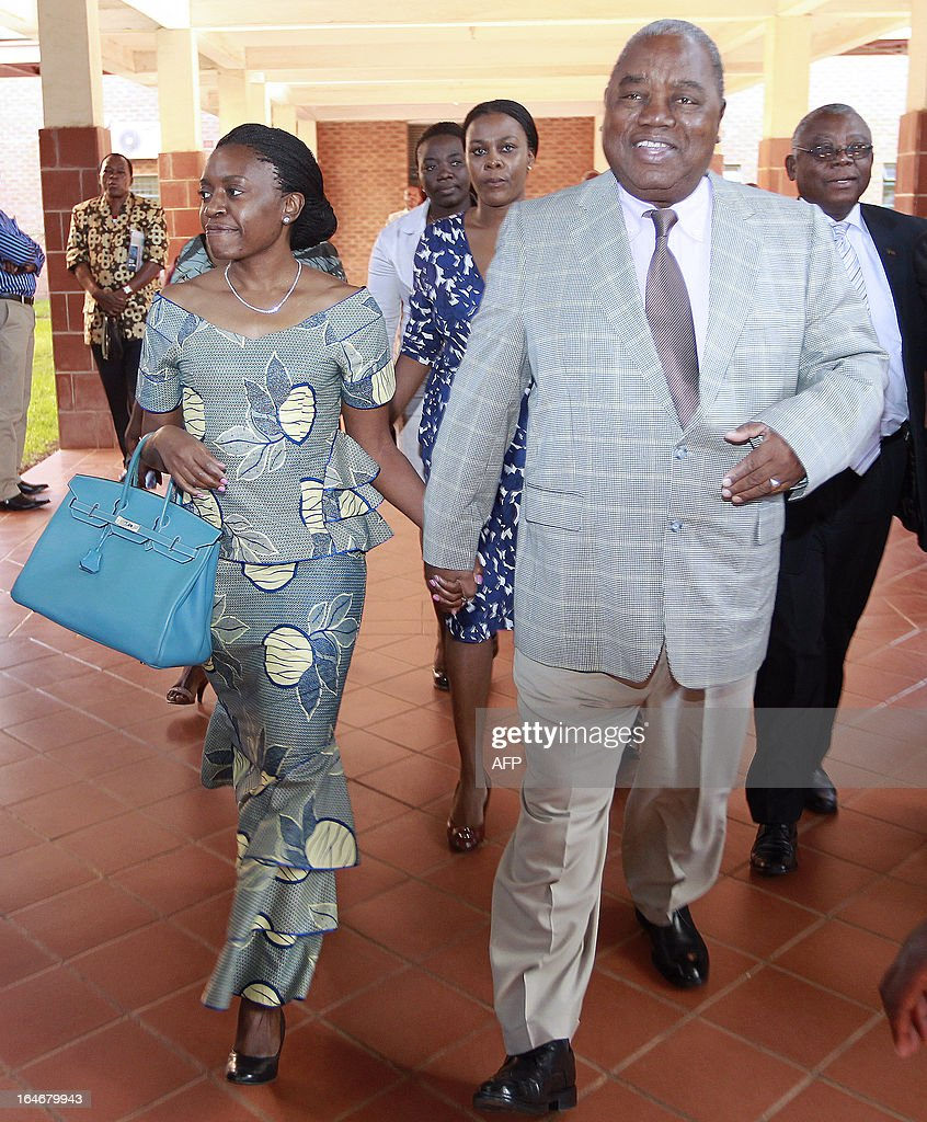 Zambia's expresident Rupiah Banda and his wife Thandiwe arrive at the Lusaka court on March 26 2013 Banda pleaded not guilty to a charge of abuse of...
