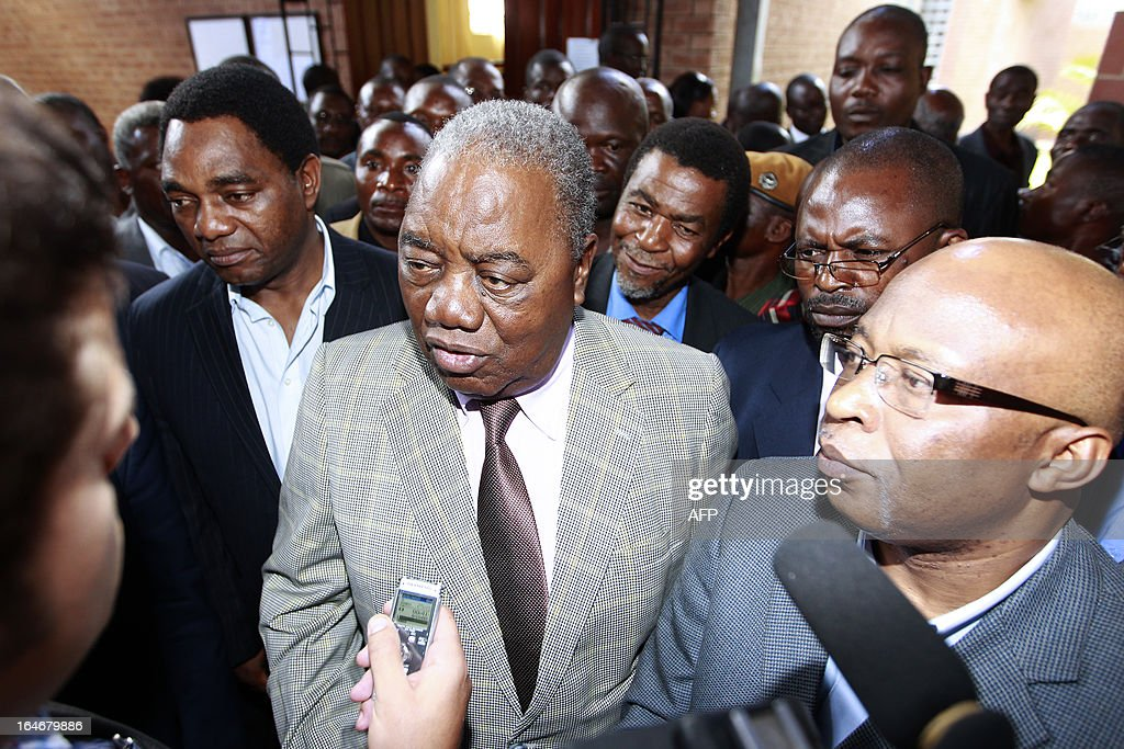 Zambia's ex-president Rupiah Banda (C), former ruling party MMD president Nevers Mumba (R) and opposition United Party for National Development (UPND) leader Hakainde Hichilema (L) speak to the press at the Lusaka magistrate court on March 26, 2013 after appearing in court. Banda pleaded not guilty to a charge of abuse of power linked to an oil contract signed while he was in office. He was arrested on March 25, 2013 after being questioned by investigators over his role in a deal with a Nigerian firm.