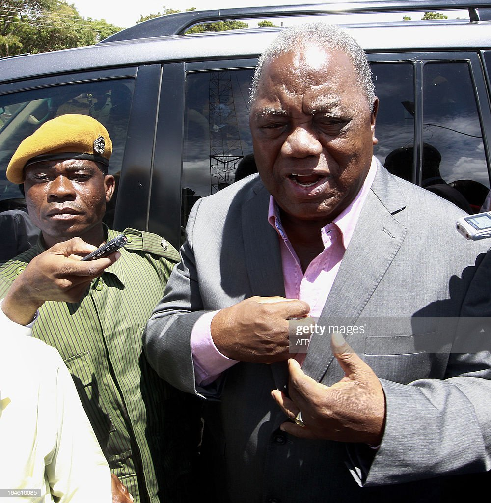 Zambia's former president Rupiah Banda addresses his supporters while under arrest on March 25 2013 at the Drug Enforcement Commission in Lusaka...
