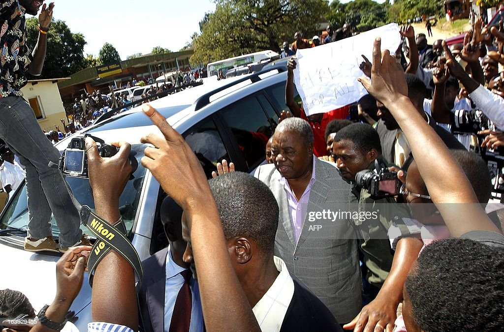 Zambia's former President Rupiah Banda arrives with his supporters at the Drug Enforcement Commission in Lusaka on March 18 2013 where he was...