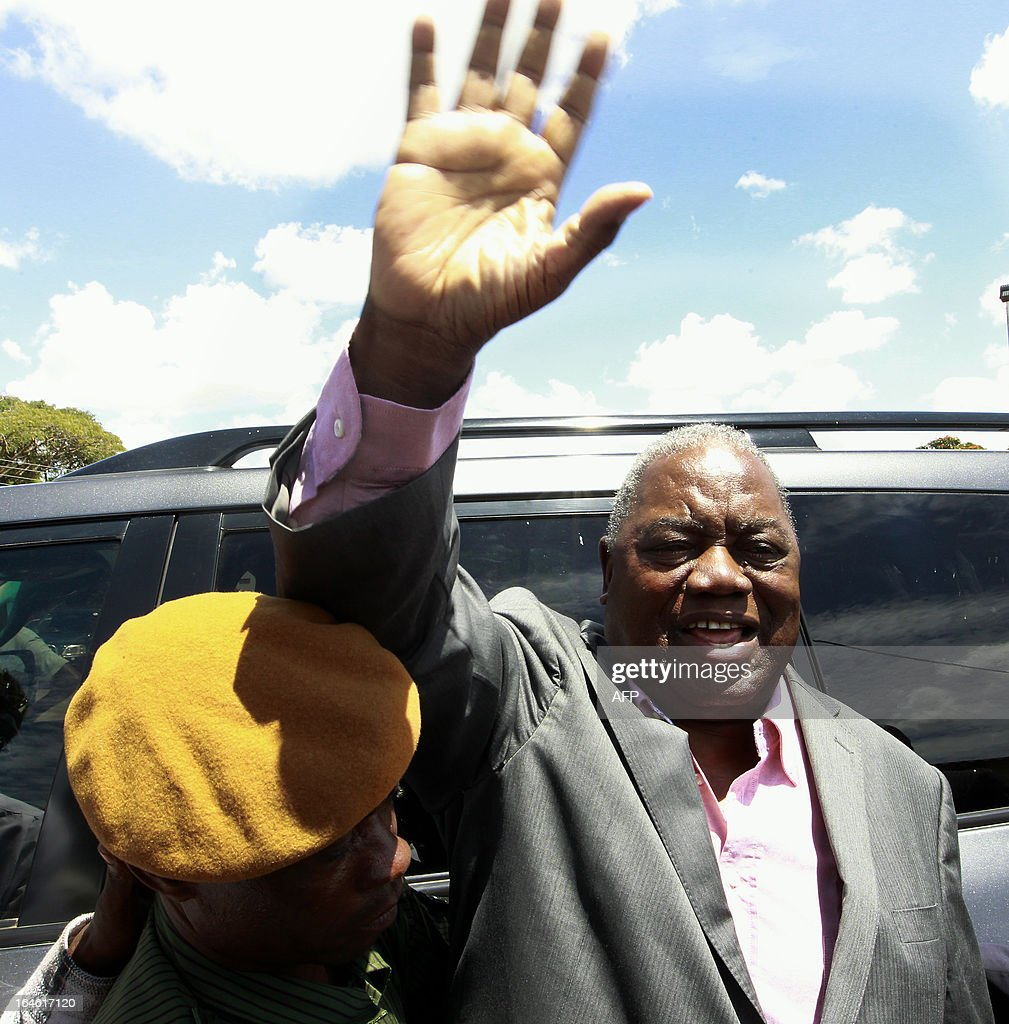 Zambia's former president Rupiah Banda waves to his supporters while under arrest on March 25 2013 at the Drug Enforcement Commission in Lusaka...