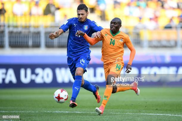 Zambia's forward Edward Chilufya and Italy's defender Giuseppe Pezzella compete for the ball during the U20 World Cup quarterfinal football match...
