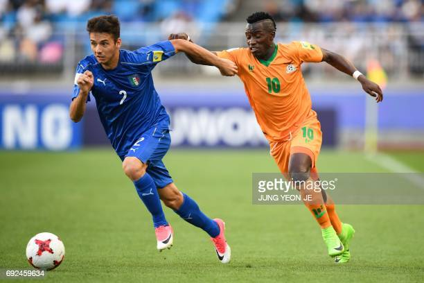 Zambia's forward Fashion Sakala and Italy's defender Giuseppe Scalera compete for the ball during the U20 World Cup quarterfinal football match...