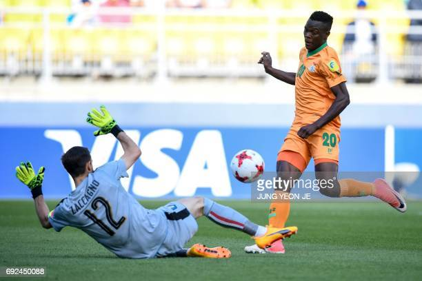 Zambia's forward Patson Daka scores a goal past Italy's goalkeeper Andrea Zaccagno during the U20 World Cup quarterfinal football match between Italy...