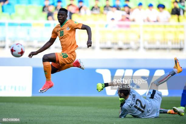 CORRECTION Zambia's forward Patson Daka scores a goal past Italy's goalkeeper Andrea Zaccagno during the U20 World Cup quarterfinal football match...
