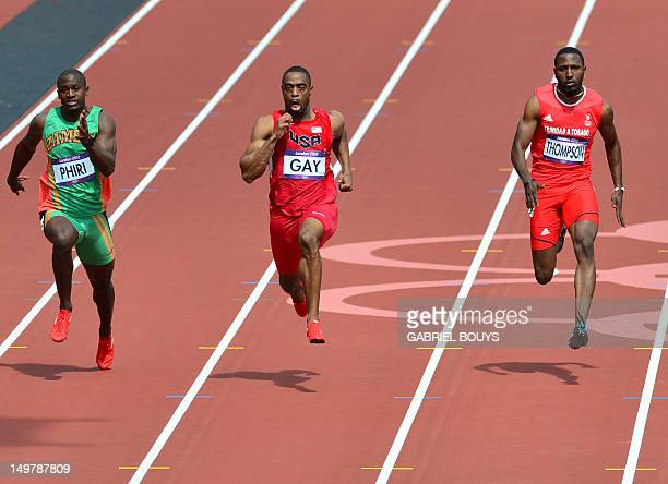 Zambia's Gerald Phiri US' Tyson Gay and Trinidad and Tobago's Richard Thompson compete in the men's 100m heats at the athletics event of the London...