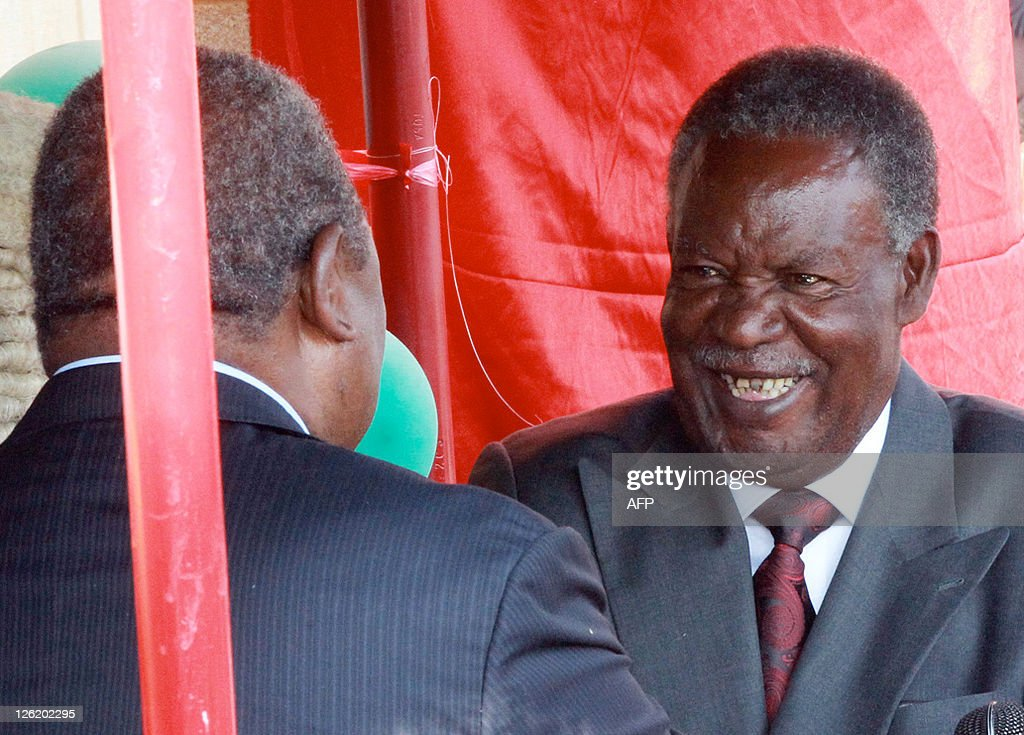 Zambia's new President Michael Sata reacts as he is congratulated by former President Rupiah Banda during his swearingin ceremony at the Supreme...