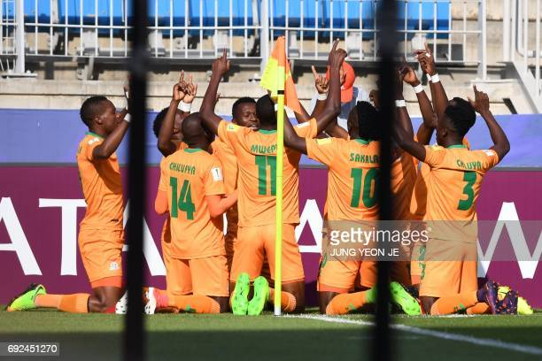 Zambia's players celebrate a goal during the U20 World Cup quarterfinal football match between Italy and Zambia in Suwon on June 5 2017 / AFP PHOTO /...