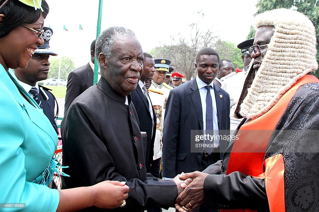 Zambia's President <a gi-track='captionPersonalityLinkClicked' href=/galleries/search?phrase=Michael+Sata&family=editorial&specificpeople=1944545 ng-click='$event.stopPropagation()'>Michael Sata</a> (2nd L) is welcomed by the Speaker of the National Assembly Dr Patrick Matibini (R) before officially opening the Zambian Parliament on September 19, 2014 in Lusaka. Zambia's elusive President <a gi-track='captionPersonalityLinkClicked' href=/galleries/search?phrase=Michael+Sata&family=editorial&specificpeople=1944545 ng-click='$event.stopPropagation()'>Michael Sata</a> made a rare public appearance on September 19, opening a new session of parliament and declaring 'I am not dead.'
