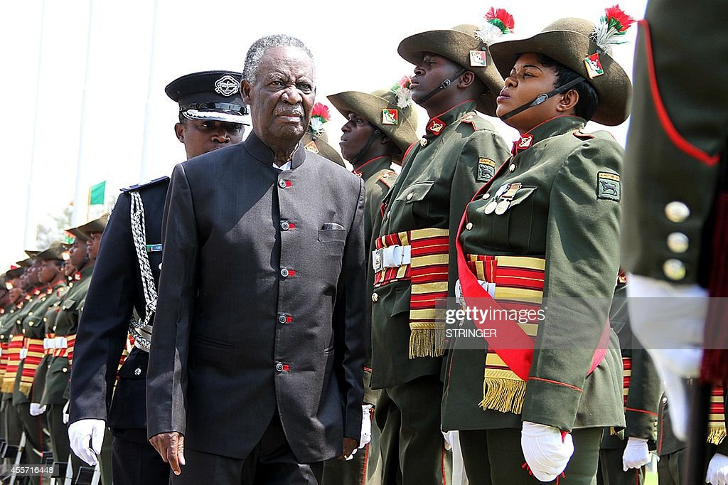 Zambia's President <a gi-track='captionPersonalityLinkClicked' href=/galleries/search?phrase=Michael+Sata&family=editorial&specificpeople=1944545 ng-click='$event.stopPropagation()'>Michael Sata</a> (L)) reviews a guard of honour outside the National Assembly building before officially opening the Zambian Parliament on September 19, 2014 in Lusaka. Zambia's elusive President <a gi-track='captionPersonalityLinkClicked' href=/galleries/search?phrase=Michael+Sata&family=editorial&specificpeople=1944545 ng-click='$event.stopPropagation()'>Michael Sata</a> made a rare public appearance on September 19, opening a new session of parliament and declaring 'I am not dead.' AFP PHOTO/STRINGER