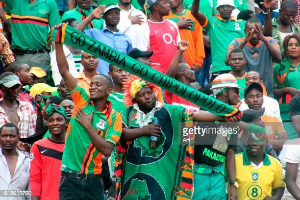 Zambia's supporters cheer their team during the FIFA World Cup qualifier between Zambia and Nigeria at the Levy Mwanawasa Satdium in Ndola on October...