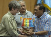 Zamboanga City Mayor Celso Lobregat hands a token to US congress member Heather Wilson while US congress member Silvestre Reyes stands behind during...
