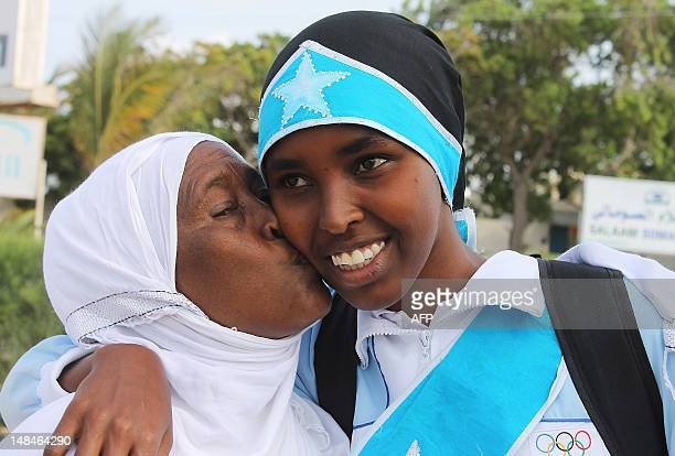 Zamzam Mahmuud Farah who will compete in the 800m race is given a kiss before boarding an airplane to London to attend the 2012 Olympic games on July...