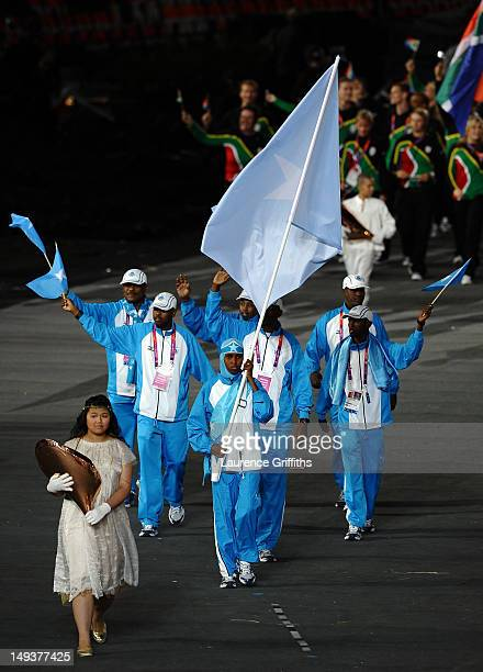 Zamzam Mohamed Farah of the Somalia Olympic athletics team carries her country's flag during the Opening Ceremony of the London 2012 Olympic Games at...