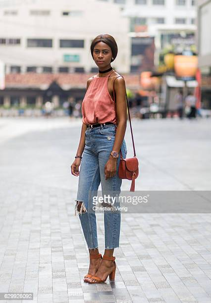 Zamzie is wearing a Zara off shoulder top a blue ripped denim jeans from Zara a Forever21 bag Cotton on heel sandals mimco watch on December 15 2016...