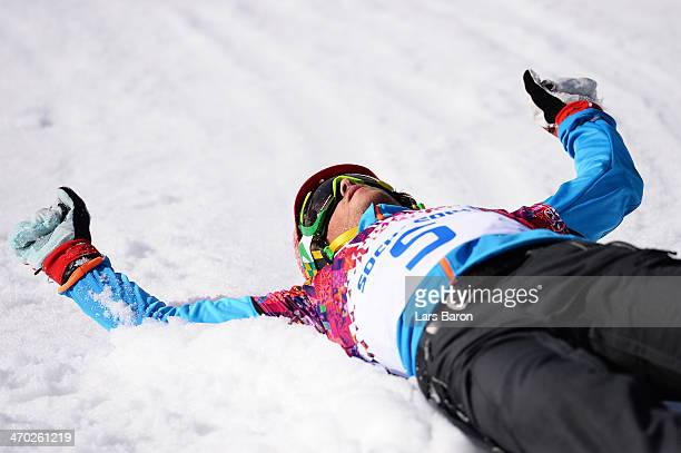 Zan Kosir of Slovenia celebrates winning the bronze medal in the Snowboard Men's Parallel Giant Slalom Finals on day twelve of the 2014 Winter...
