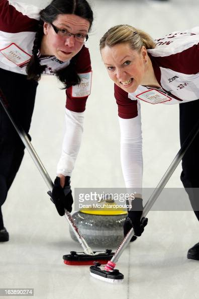 Zanda Bikse and Dace Munca of Latvia sweep in the match between Latvia and Japan during Day 2 of the Titlis Glacier Mountain World Women's Curling...
