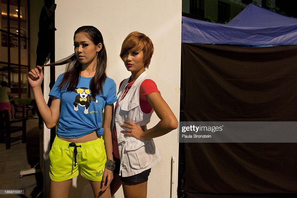 Zandea,18, and Jessica, 21, pose showing off their clothing backstage during a show featuring OPT jeans December 8, 2011 in Yangon, Myanmar. The pace of change in Myanmar brought U.S Secretary of State Hillary Clinton to the country where she discussed further paths to reform and crucial talks with both Aung San Suu Kyi and the highest levels of the Burmese government. For many years Myanmar has suffered from economic stagnation, political repression and international isolation. In March the army handed power to a civilian government after almost five decades of the military regime's strong arm rule. The handover took place after a controlled election under a new constitution that preserved much of the military clout. Internet has been loosened up as previously inaccessible foreign news and opposition websites have been unblocked.
