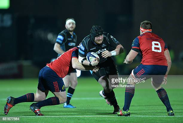 Zander Fagerson of Glasgow Warriors is tackled by C J Syander and John Ryan of Munster Rugby during the European Rugby Champions Cup match between...