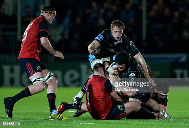 Zander Fagerson of Glasgow Warriors is tackled by Dave Kilcoyne of Munster Rugby during the European Rugby Champions Cup match between Glasgow...