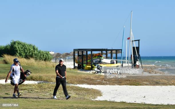 Zander Lombard of South Africa and caddie walk by the ocean on the 15th hole during the third round of The Rocco Forte Open at The Verdura Golf and...
