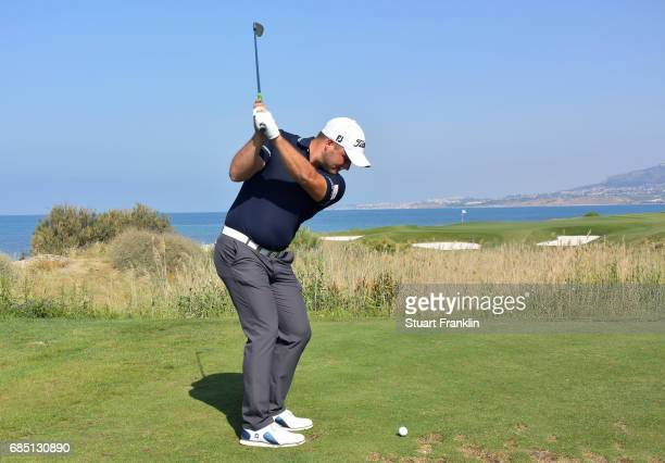 Zander Lombard of South Africa plays a shot on the seventh hole during the second round of The Rocco Forte Open at The Verdura Golf and Spa Resort on...