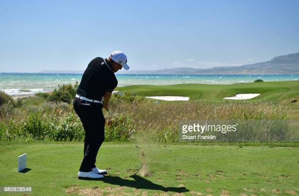 Zander Lombard of South Africa plays a shot on the seventh hole during the third round of The Rocco Forte Open at The Verdura Golf and Spa Resort on...
