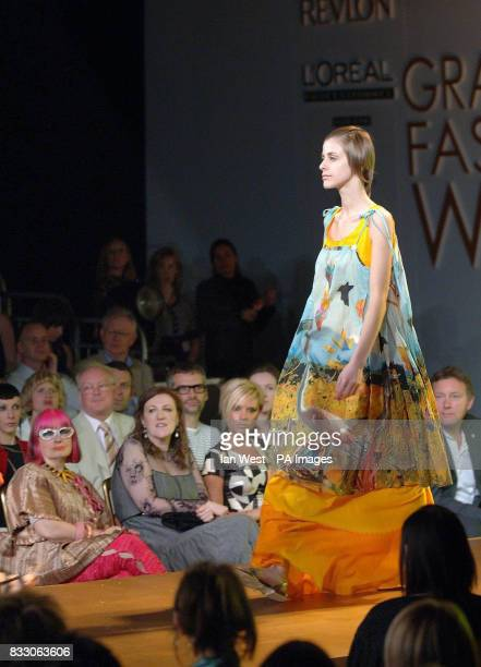 Zandra Rhodes Glenda Bailey and Victoria Beckham watch from the audience during the River Island Graduate Fashion Week Awards in Battersea Park south...