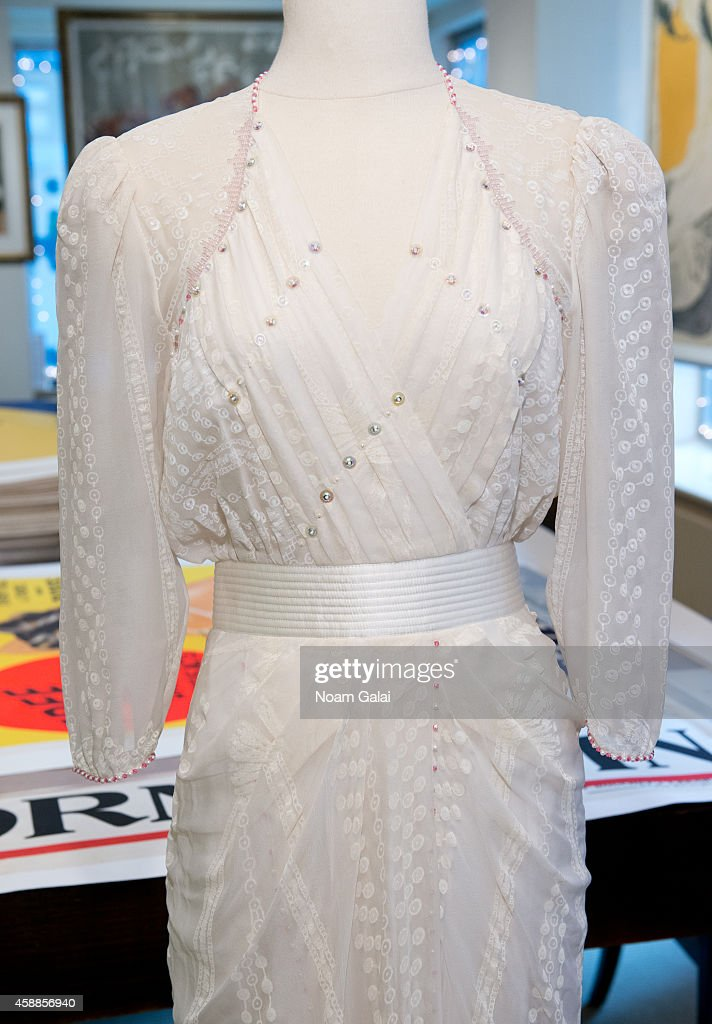 A Zandra Rhodes ivory silk chiffon gown embellished with simulated pearls and deep pink faceted glass worn by HRH Princess Diana to the Birthright benefit at the London Palladium, May 1987, as seen on display at Ross Art Gallery on November 12, 2014 in New York City.