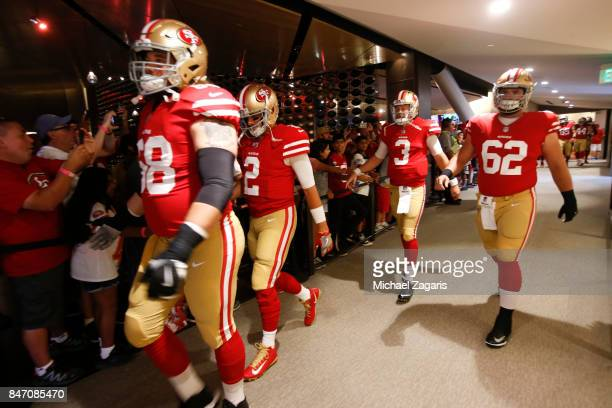 Zane Beadles Brian Hoyer CJ Beathard and Erik Magnuson of the San Francisco 49ers head to the field prior to the game against the Carolina Panthers...