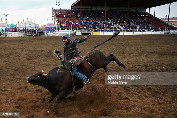 Zane Lambert of Westbourne Manitoba in action during the Bull Riding 'Battle for the Buckle' competition during the 62nd Annual Wainwright Stampede...