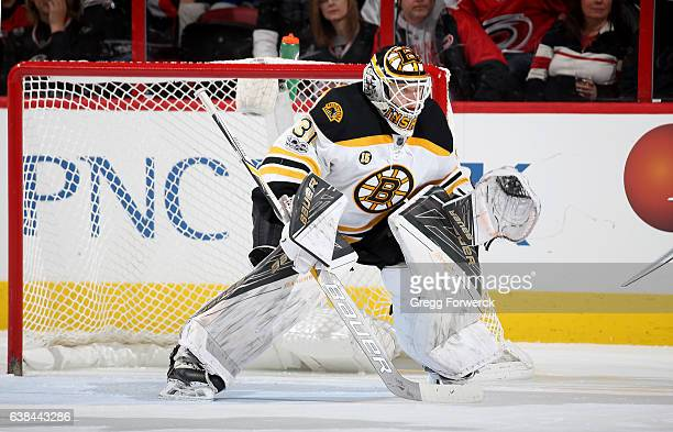 Zane McIntyre of the Boston Bruins crouches in the crease to protect the net during an NHL game against the Carolina Hurricanes on January 8 2017 at...
