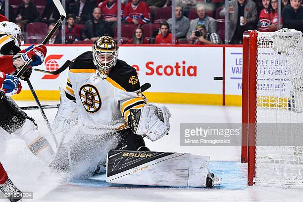 Zane McIntyre of the Boston Bruins is unable to stop the puck and allows a goal in the second period during the NHL game against the Montreal...