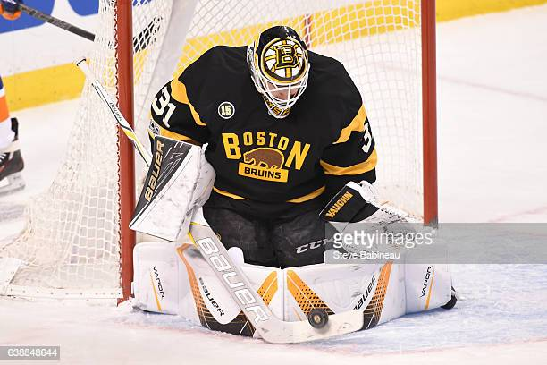 Zane McIntyre of the Boston Bruins stops the puck against the New York Islanders at the TD Garden on January 16 2017 in Boston Massachusetts