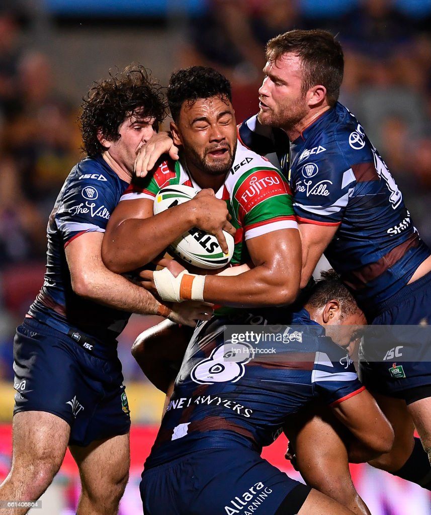 Zane Musgrove of the Rabbitohs is wrapped up by the Cowboys defence during the round five NRL match between the North Queensland Cowboys and the South Sydney Rabbitohs at 1300SMILES Stadium on March 31, 2017 in Townsville, Australia.
